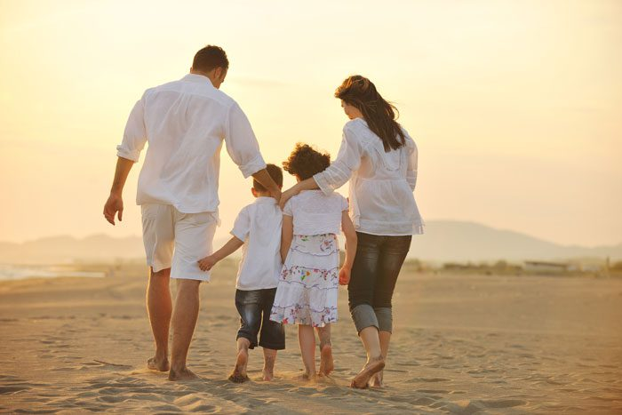 Family walking on the beach - Life Insurance Financial Planning - Grabowski Financial Planning